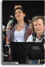 "VTC at the EuroFest. Özge Göktepe while singing ""Vardar Ovası"", next to her, Erika Gerson (tambourine)"