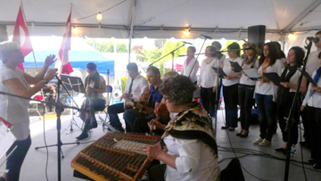 Vancouver Turkish Choir at the Greek Summer Festival, June 27, 2014. On the left: Sevgi Dogan (conductor); instrumentalists from left: Lisa Ronald (clarinet), İlyas Kayran (darbukka), Erman Yavuz (guitar), Mark Hamilton (laouto), Laura Blumenthal (santouri); vocalists: Özge Göktepe, Bahar Çinarli, Filiz Bingöller, Bahar Yilmaz, İrem Cingoz, Burcu Koçer.